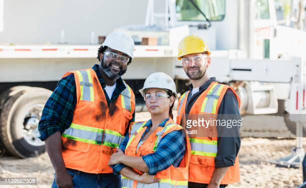 woman in charge at construction site - construction worker stock pictures, royalty-free photos & images
