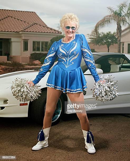 woman in cheerleader uniform - cheerleader stock pictures, royalty-free photos & images