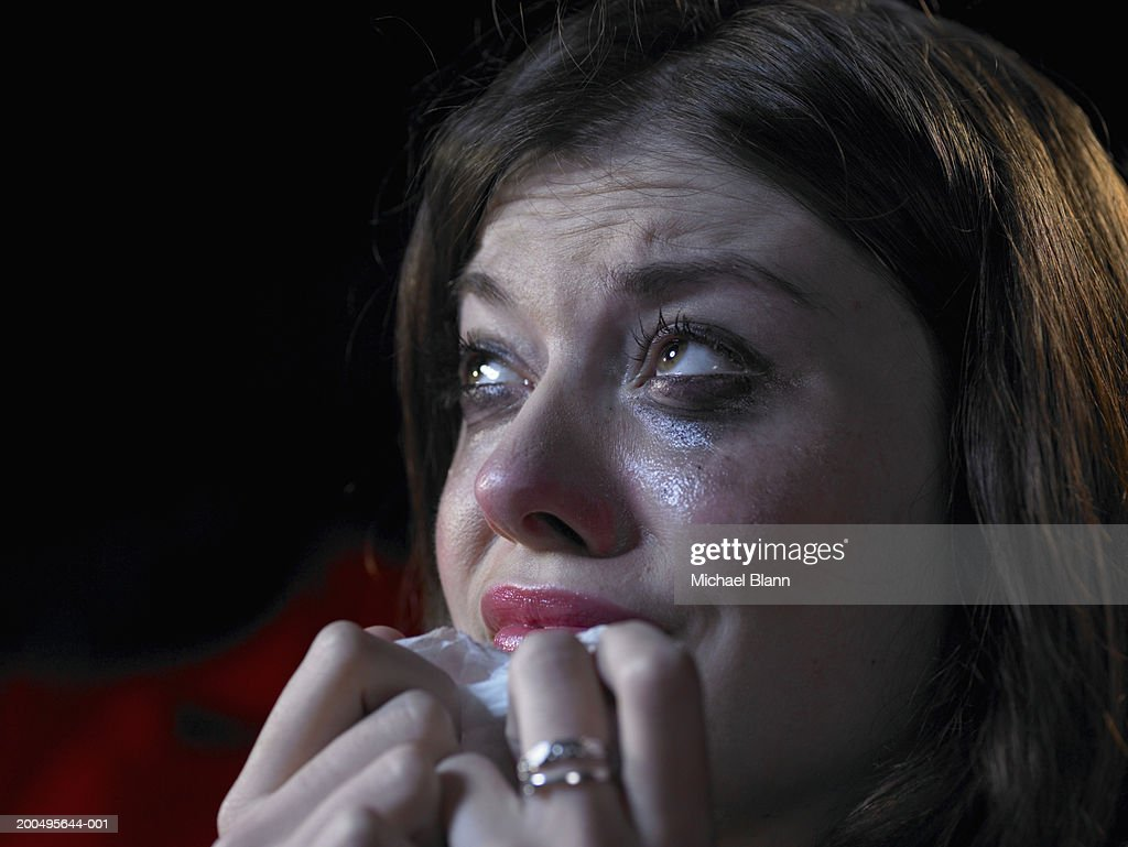 Woman in cinema crying, close-up : Stock Photo