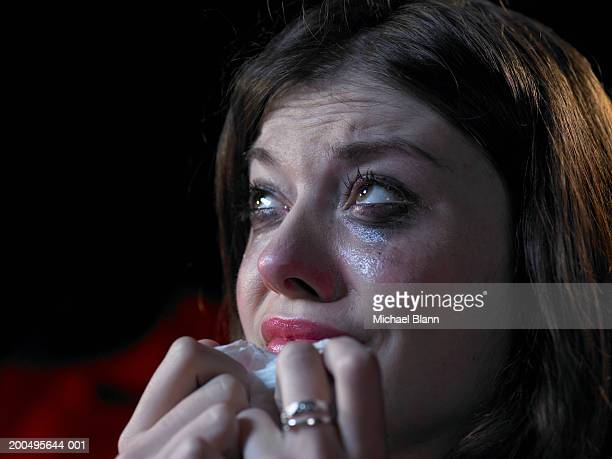 Woman in cinema crying, close-up