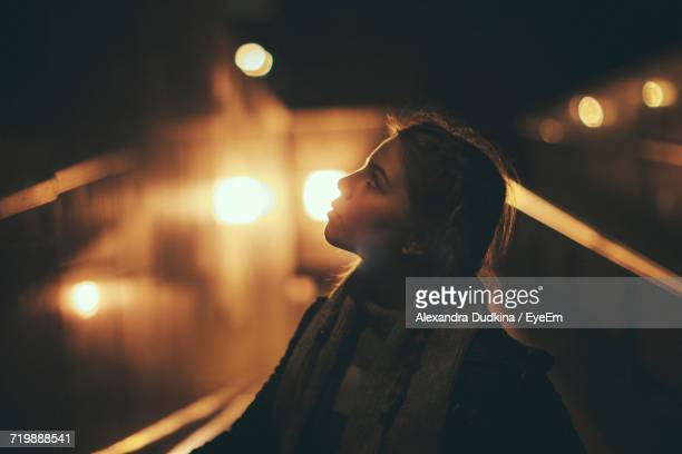 Woman In City At Night