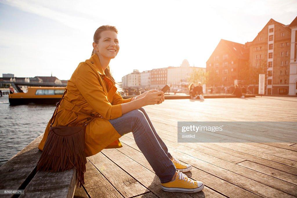 Woman in city enjoyng sun. : Stock Photo