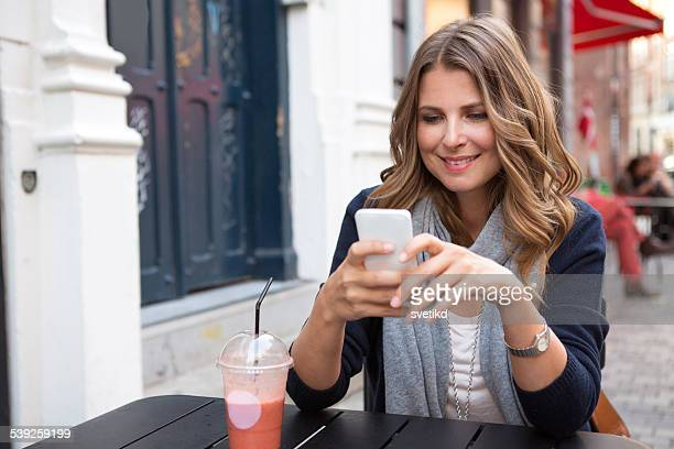 woman in city using smart phone. - danish culture stock pictures, royalty-free photos & images