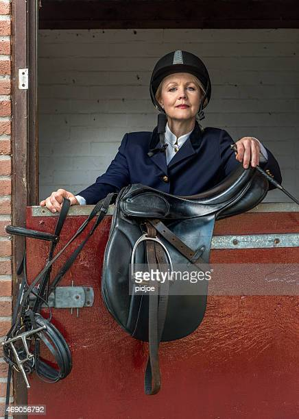 Woman in classic horse ridding tenue ,Equestrian sport - dressage