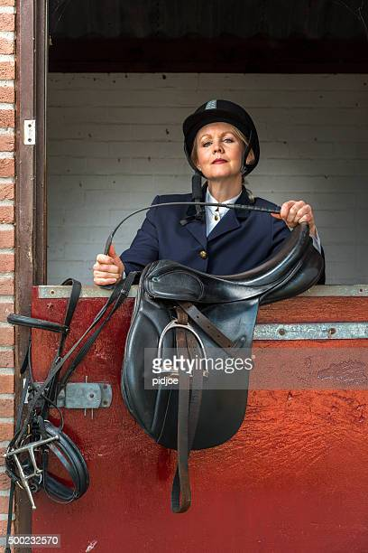 Woman in classic horse ridding tenue ,Equestrian sport - dressage
