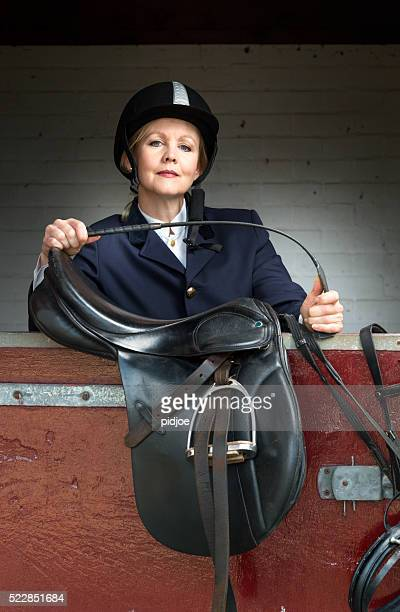 woman in classic horse ridding tenue ,equestrian sport - dressage - women with whips stock pictures, royalty-free photos & images