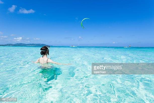 Woman in clear tropical water, Okinawa, Japan