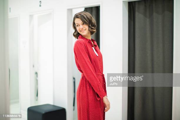 woman in clothing store - dress stock pictures, royalty-free photos & images