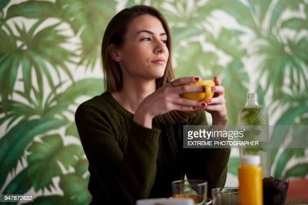 woman in coffee shop - one young woman only stock pictures, royalty-free photos & images