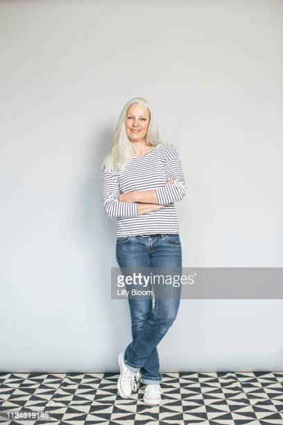 woman in confident pose - white pants stock pictures, royalty-free photos & images