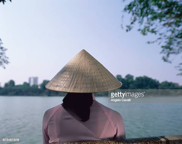 Woman in Conical Hat Along River