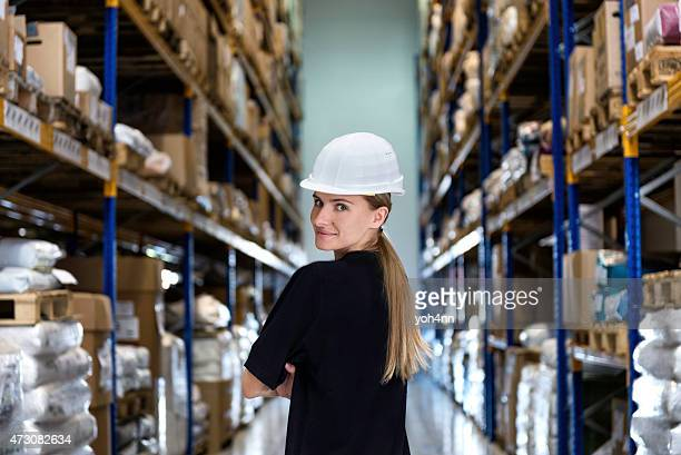 Woman in corridor of warehouse