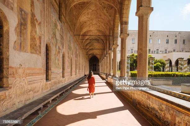 woman in corridors, santa chiara monastery, campania, italy - naples italy stock pictures, royalty-free photos & images