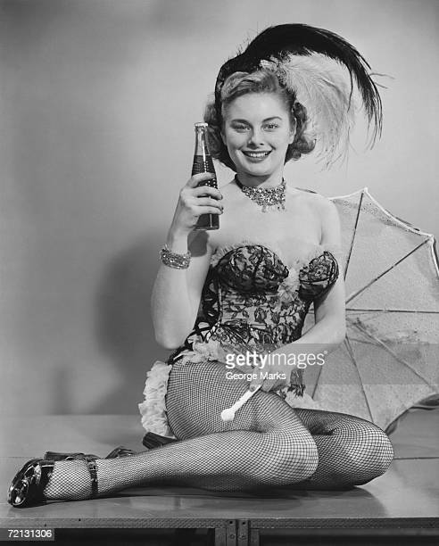 woman in corsets and fancy hat posing in studio (b&w), portrait - vintage corset stock photos and pictures