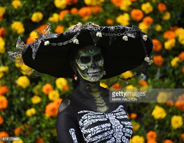 A woman in costume gets her portrait taken during the annual Dia de los Muertos festival at the Hollywood Forever cemetery in Hollywood California on...