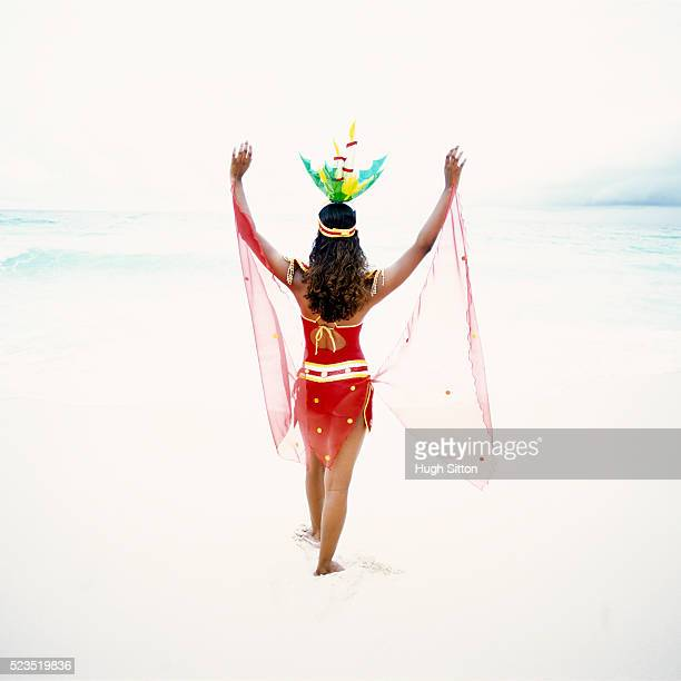 Woman in Costume on Beach