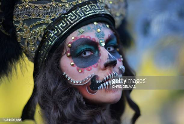 A woman in costume poses as she attends Hollywood Forever Cemetery's 19th annual Dia De Los Muertos event on October 27 2018