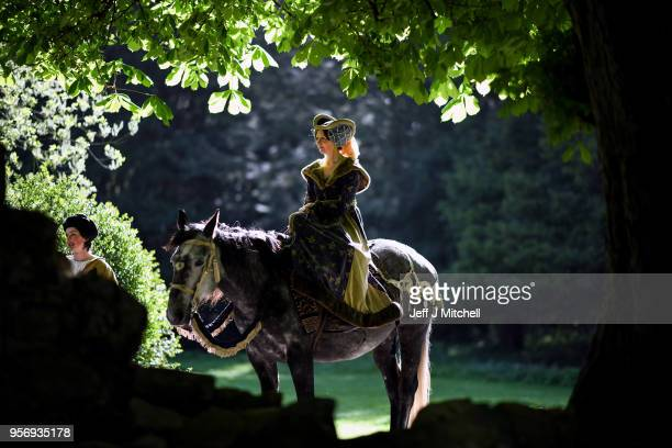 A woman in costume sits on a horse as competitors take part in the International Medieval Combat Federation World Championships at Scone Palace on...