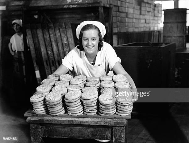 Woman in crumpet factory, portrait (B&W)
