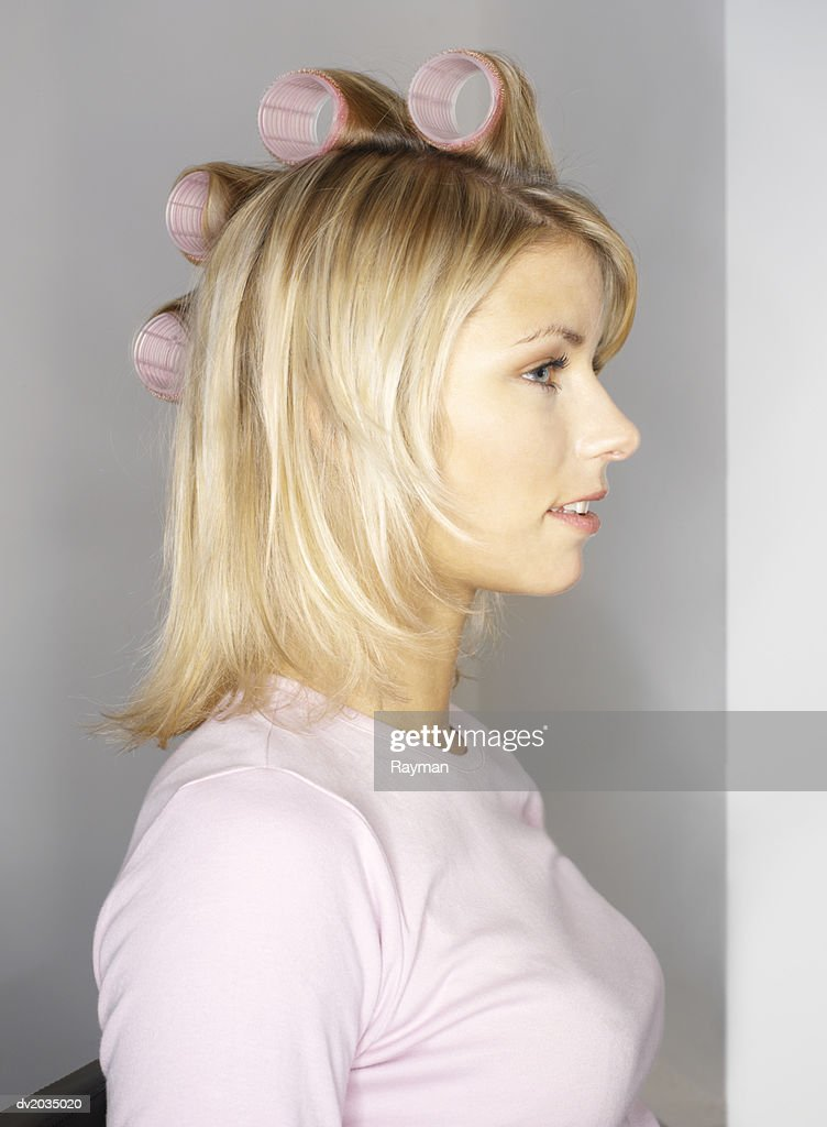 Woman in Curlers : Stock Photo