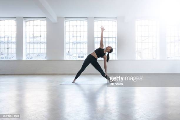 Woman in dance studio stretching