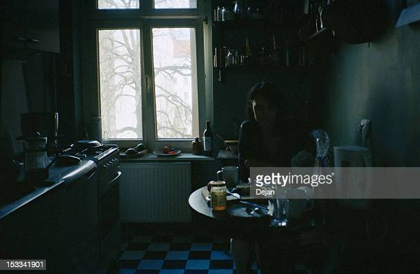 woman in dark kitchen - dark stock pictures, royalty-free photos & images