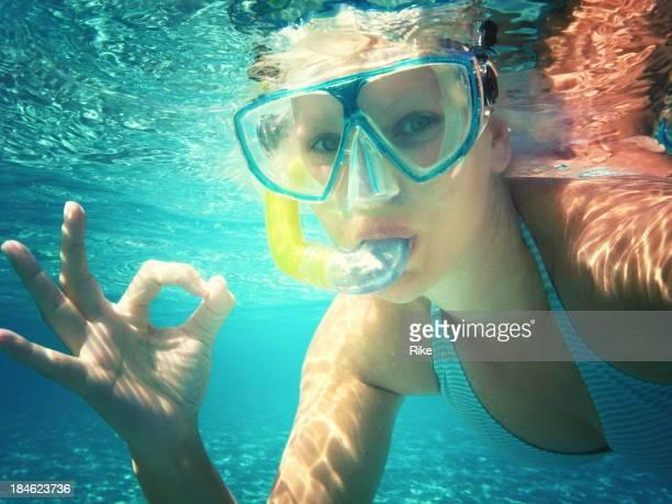 Woman in deep blue sea