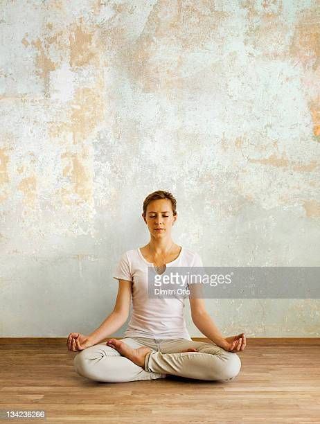 Woman in deep meditation seated in lotus position