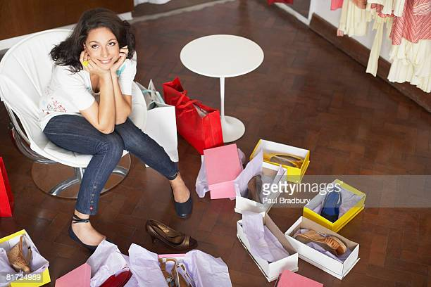 Woman in department store trying on shoes and smiling