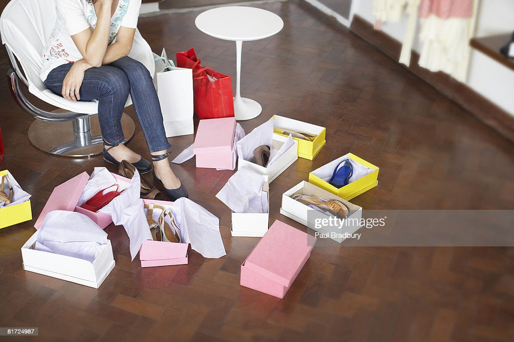 Woman in department store trying on shoes : Stock Photo