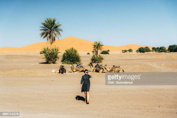 Woman in desert near the camels