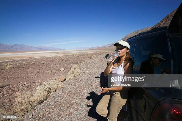 Woman in desert with vehicle