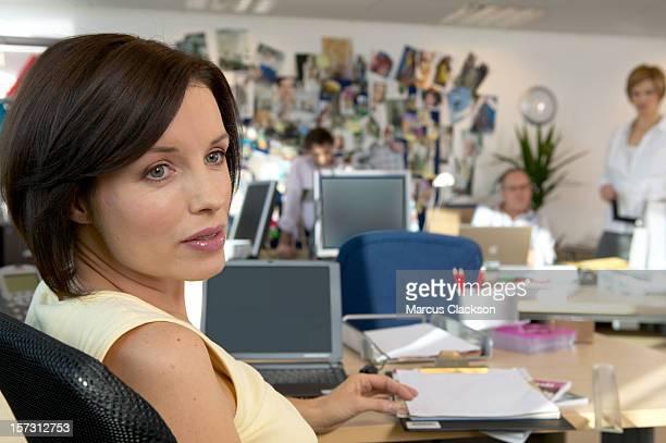 Woman in Design Studio listening to colleague