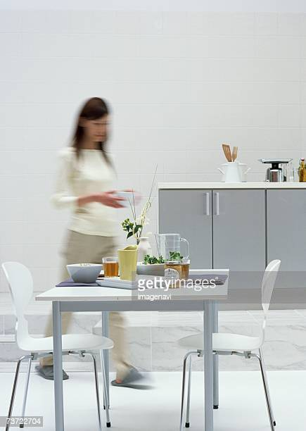 Woman in dining room
