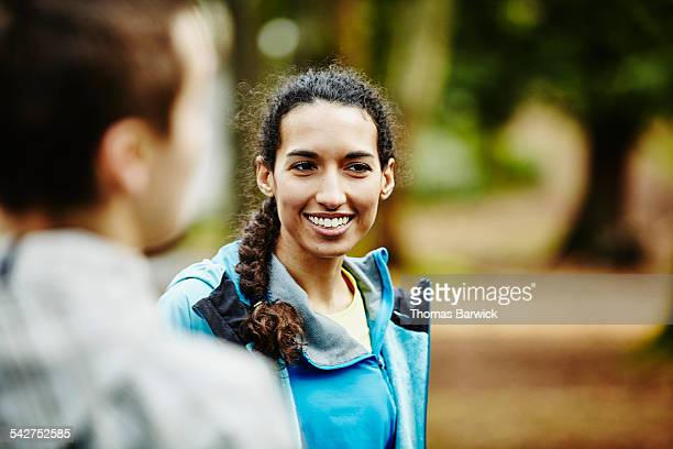Woman in discussion with friends after trail run