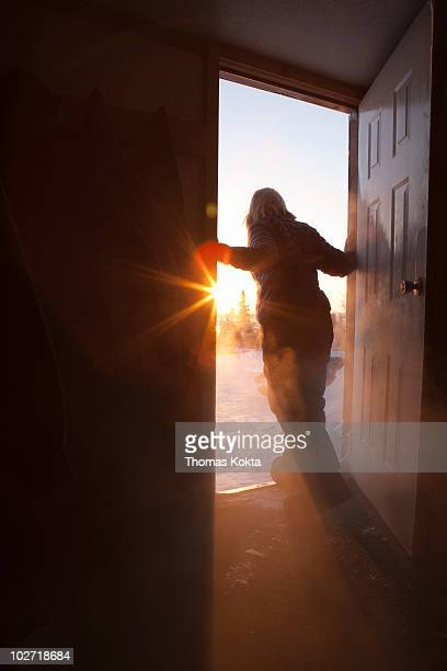 woman in doorway looking outside - doorway stock pictures, royalty-free photos & images