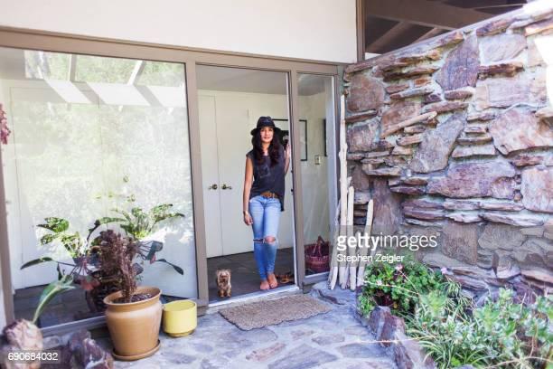 Woman in doorway to home