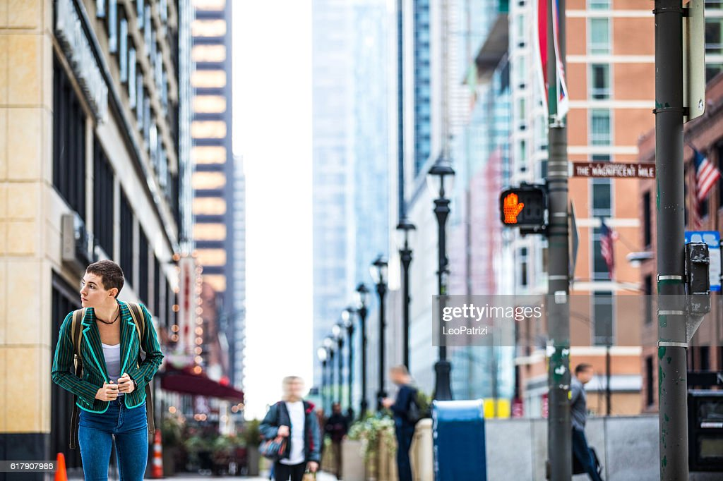 Woman in downtown Chicago waiting to cross the street : Stock Photo