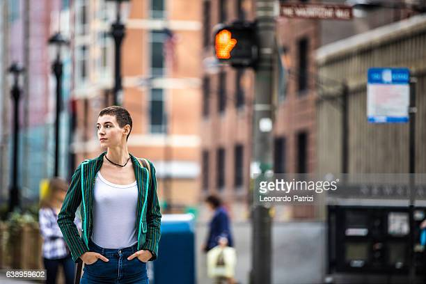 Woman in downtown Chicago waiting to cross the street