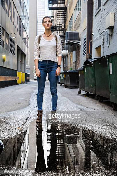Woman in downtown Chicago walking down an alley