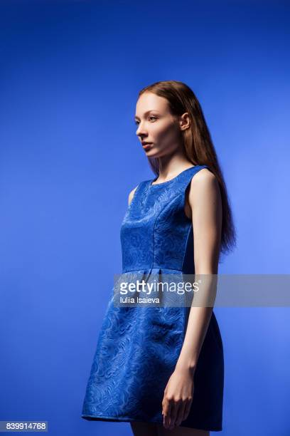 woman in dress on blue - blue dress stock pictures, royalty-free photos & images