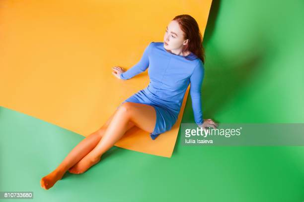 Woman in dress on colorful floor