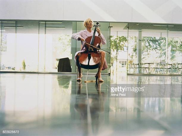 woman in dress playing cello - cellist stock pictures, royalty-free photos & images