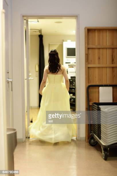 woman in dress walking backstage,rear view - long dress stock pictures, royalty-free photos & images