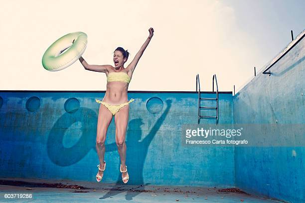 Woman in empty swimming pool