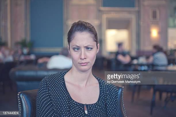 Woman in European cafe, crossed eyes