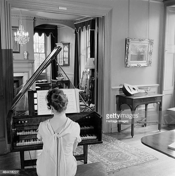 Woman in evening dress playing the harpsichord Fenton House London 19601965 The interior of Fenton House 3 Hampstead Grove