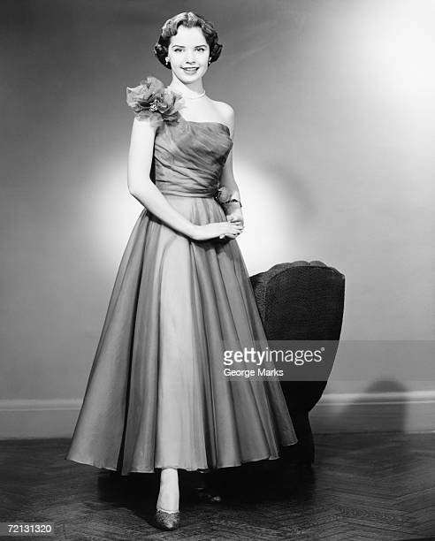 woman in evening dress posing in studio (b&w), portrait - evening wear stock pictures, royalty-free photos & images