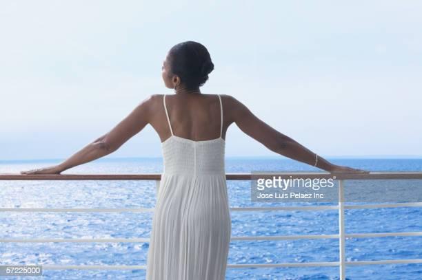 Woman in evening gown watching ocean