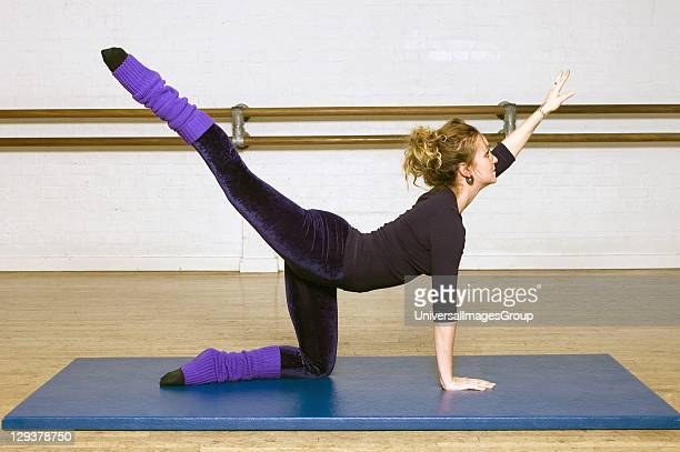 Woman in exercise class practicing Pilates arabesque routine A exercise class at the Body Control Centre in London perform a Pilates Arabesque...